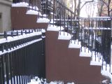 Snow covered steps to a brownstone on the east side of Manhattan, February 25, 2005